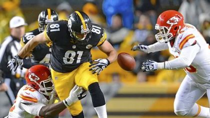 Steelers tight end David Paulson looses control of the football against the Chiefs.