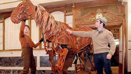 "Danny Beiruti, right, is one of the three puppeteers controlling the horse, Joey, in ""The War Horse"" at the Benedum Center. The show runs through Nov. 18."