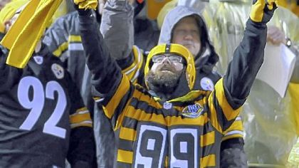 IMPLORING THE GODS? A Steelers fan who braved the elements Monday night at Heinz Field does his best to will the team to victory. The Steelers went to 6-3 with a 16-13 overtime victory against Kansas City.