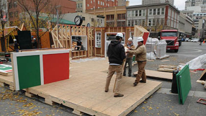 "Pre-assembled sections are moved into place for the assembly of ""Santa's House"" in Market Square."