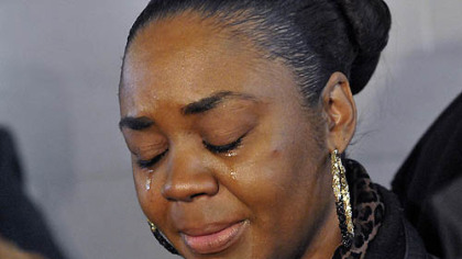 Latonya Green, mother of Leon Ford, who was shot by Pittsburgh Police during a traffic stop November 12, 2012, cries during a press conference at which the family called upon the city and the police to allow them to see him in the hospital.