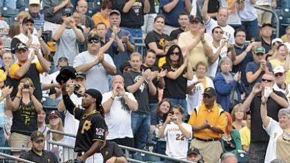 Pirates fans give center fielder Andrew McCutchen a standing ovation as he makes his way to the PNC Park dugout during the team&#039;s season finale against Atlanta in October.