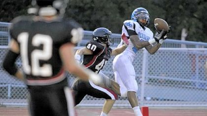 Woodland Hills&#039; Tom Greene caught a touchdown pass against Upper St. Clair in the season opener.