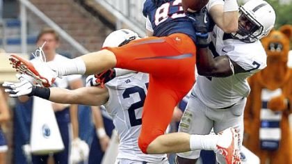 Safety Stephen Obeng-Agyapong, right, comes up to defend Virginia's Jake McGee earlier this season.