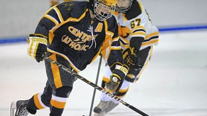 Central Catholic's Chris McCambridge carries the puck up ice against North Allegheny during the Vikings' season opener.