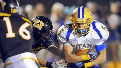 West Mifflin running back Jimmy Wheeler carries the ball against Thomas Jefferson earlier this season.