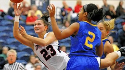 Duquesne&#039;s Belma Nurkic slips through the Delaware defense for a shot in the first half Wednesday night at Palumbo Center.