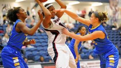 Delaware&#039;s Lauren Carra, right, defends Duquesne&#039;s Wumi Agunbiade Wednesday at Palumbo Center. Agunbiade had 17 points and 12 rebounds.