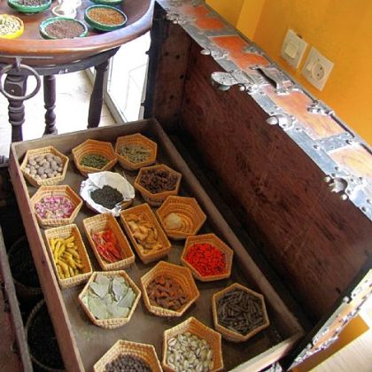 A shop in Marrakesh displays saffron, turmeric, harissa, and cinnamon, the signature spices of North African cuisine.