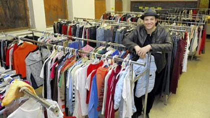 Brandon Grbach stands in the clothing room in the former Hartman school, 1200 Wolfe Ave., North Braddock.