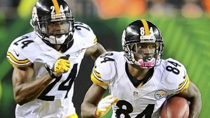 Antonio Brown picks up good yardage on punt return as Ike Taylor blocks for him against the Bengals Sunday at Paul Brown Stadium in Cincinnati.