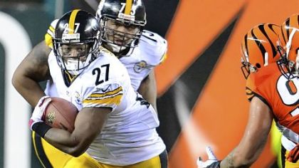 Steelers Jonathan Dwyer picks up yardage against the Bengals Sunday night in Cincinnati. Dwyer finished with 122 yards, the most by a Steelers back this season.
