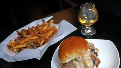 Winghart's 'Oly Cah! burger, which is topped with grilled chipped-chopped ham and beer cheese, served here with fries and a neat Aberlour A'bunadh single-malt Scotch whisky.