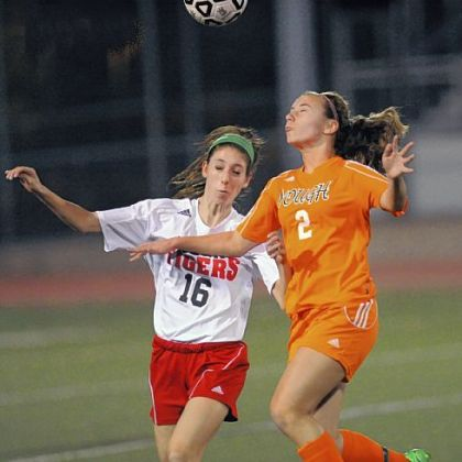Moon defender Sydney Schipani, left, and Yough forward Hannah Ponitz fight for possesion Oct. 24 in a WPIAL Class AA quarterfinal at Chartiers Valley High School.