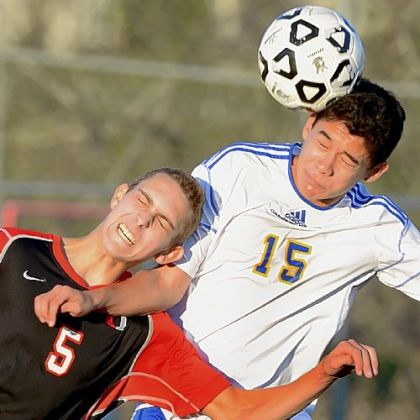 Upper St. Clair's Kevin Muck, left, battles with Canon-McMillan's Ivan Viveros during a PIAA Class AAA quarterfinal match Saturday at Chartiers Valley High School.