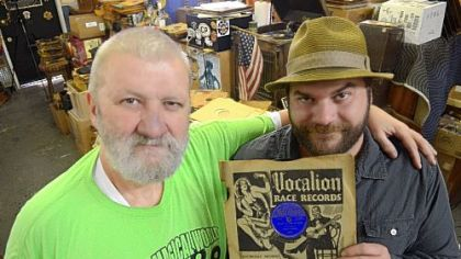 "Jerry Weber, left, of Jerry Records in Squirrel Hill, and his son, Willie, hold a rare copy of Robert Johnson's ""I Believe I'll Dust My Broom"" on the Vocalion label. The ""holy grail of 78s"" is estimated to be worth $6,000 to $12,000."