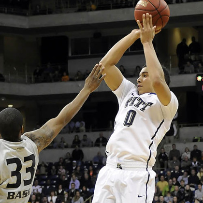 Pitt's James Robinson puts up a shot against Oakland's Ryan Bass in the second half.