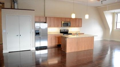 Most of the first- and fourth-floor units have 16-foot ceilings. The kitchens feature stainless-steel Whirlpool appliances, two choices of granite countertops and Jim Bishop maple cabinets in three shades of stain.
