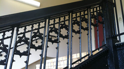 Cast-iron balustrade on a set of stairs in the lofts.