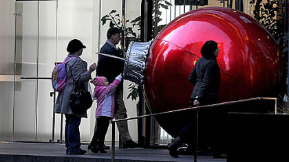 A large red ornament  greets commuters in front of the K&L Gates Center, Downtown, on the morning of Light Up Night.