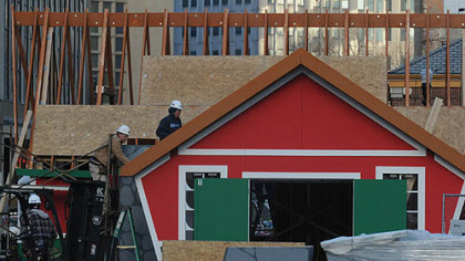 "Work continued this afternoon on the assembly of ""Santa's House"" in Market Square."