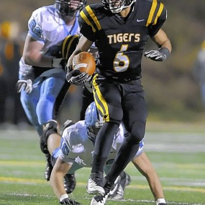 North Allegheny's Elijah Zeise carries against Seneca Valley Friday.