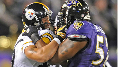 Hines Ward, left, and Ray Lewis get in each other&#039;s face in the 2010 game in Baltimore.