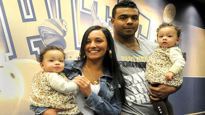 Pitt running back Rushel Shell with Marissa Pursley and their twin daughters Amiyah, left, and Arionna at the Pitt practice facility.
