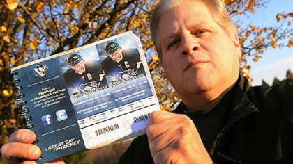 Ron Valerino, longtime Pens season ticket holder, flashes his tickets for the 2012-13 season. The question lingers: Will he ever get to use them?