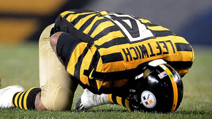 Steelers quarterback Byron Leftwich holds his left shoulder after getting sacked by Ravens safety James Ihedigbo late in the fourth quarter.