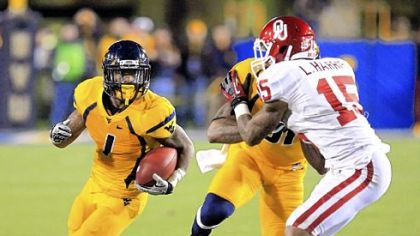 Tavon Austin set a I-A division record Saturday with 572 all-purpose yards, including a West Virginia record 344 rushing yards.