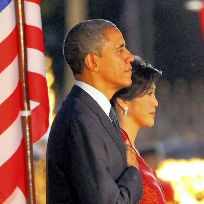President Barack Obama and Thai Prime Minister Yingluck Shinawatra listen to national anthems Sunday during a welcome ceremony in Bangkok.