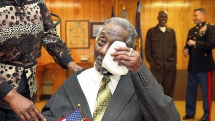 Lenel Moore, 87, wipes tears away after he is awarded his Congressional Gold Medal during a surprise ceremony Saturday at Veterans of Foreign Wars Post 943 in Ashtabula, Ohio. Congress authorized the gold medals in June for those who served as the first African-American Marines during World War II. Blacks were allowed to enlist in the Marines after President Franklin D. Roosevelt issued an executive order mandating enlistment regardless of race in 1942. They trained at a segregated base at Monford Point, N.C.