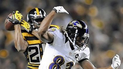Steelers cornerback Ike Taylor breaks up a pass intended for Ravens receiver Torrey Smith in the first quarter Sunday at Heinz Field.