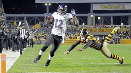 The Ravens' Jacoby Jones runs into the end zone on a punt return in the first quarter Sunday at Heinz Field.