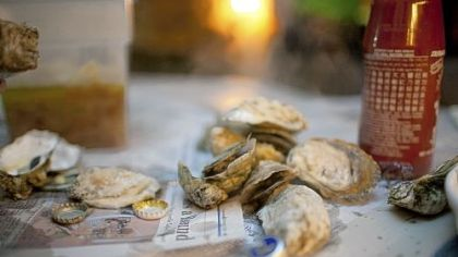 For the classic oyster roast you don't need a tablecloth.  Newspapers in the trunk of the car, destined to be recycled, work just fine.