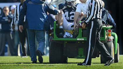 Penn State linebacker Michael Mauti clutches his helmet after injuring his left knee in the first half against Indiana at Beaver Stadium, State College on Nov. 17.