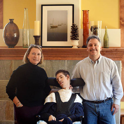Lisa and Frank Falcione with their son Andy in the family room of their new home in Marshall.