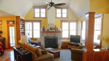 Lisa Falcione based the look of the family room on a photo she saw in a library book. The fireplace faced in slate and quartzite came from Hearth & Home.