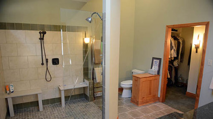 The master bathroom has a 6 1/2- by 6 1/2-foot shower with room for Andy Falcione, his wheelchair and a helper. The etched glass door is by Emerald Art Glass.