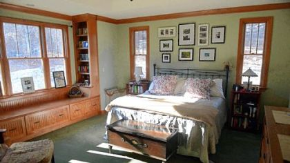 Master bedroom has a large window seat with drawers for storage. The windows are by Andersen.