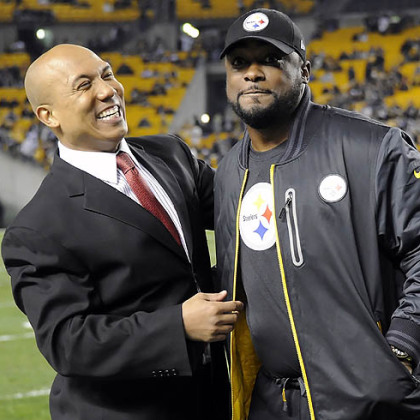Steelers head coach Mike Tomlin visits with former wide receiver Hines Ward before the game Sunday night against the Ravens at Heinz Field.