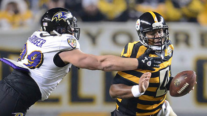 Ravens Paul Kruger pulls down Steelers quarterback Byron Leftwich.