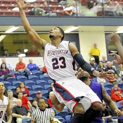 Duquesne&#039;s Jeremiah Jones drives to the basket against James Madison in the first half Monday night at A.J. Palumbo Center.