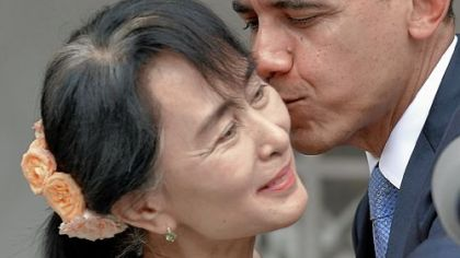President Barack Obama kisses Myanmar opposition leader Aung San Suu Kyi after speaking to the media following their meeting at her residence in Yangon on Monday.