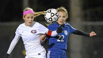 Greensburg Central Catholic's Malea Fabean, left, jostles with Shady Side's Tori Winter during PIAA semifinal match.