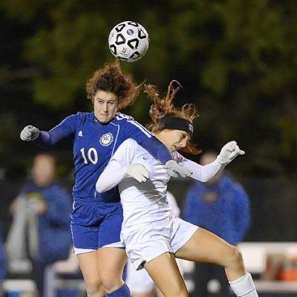 Shady Side's Zoe Schoen, left, heads the ball above Greensburg Central Catholic's Cassie Sauter in the PIAA semifinals.