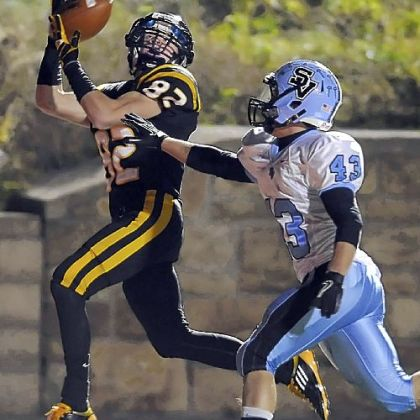 North Allegheny's Gregg Garrity pulls in a touchdown pass over Seneca Valley's Tyler Bommer last Friday night.