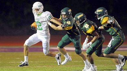 South Fayette&#039;s Grant Fetchet tries to get away from Seton-LaSalle defenders during a regular-season game.