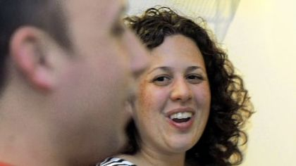 Randi Rumbaugh, left, who is Jewish, talks with her husband Nick, 33, who is Catholic, about interfaith holldays in an interfaith couples workshop &quot;Pre-Christmas/Chanukah Conversation.&quot;